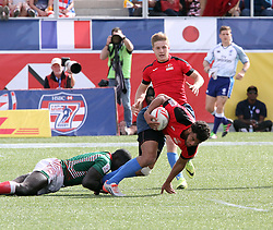March 5, 2017 - Las Vegas, Nevada, United States of America - Russian Eme Patris Peke is tackled by Kenyan players during the 2017 USA Sevens International Rugby Tournament game between Kenya and Russia on March 4, 2017  at Sam Boyd  Stadium  in Las Vegas, Nevada (Credit Image: © Marcel Thomas via ZUMA Wire)