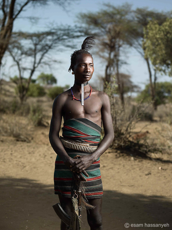 Dula mamero is a young Hamer warrior who poses proudly for a portrait.