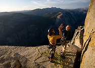 Madaleine Sorkin<br /> and Kate Rutherford celebrating after a free ascent of the Regular Route on Half Dome, Yosemite, CA