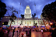 Los Angeles city hall is bathed in light at dusk while surrounded by Occupy LA protesters on Saturday, November 12, 2011 in Los Angeles, Calif. (Photo by Gabriel Romero ©2011)
