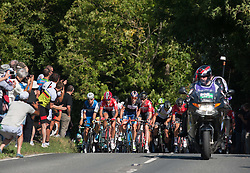 © Licensed to London News Pictures. 08/09/2016. Selsley, Gloucestershire, UK. The Tour of Britain cycle race. Picture of the main group behind the leading group in the King of the Mountain section up to Selsley Common. Photo credit : Simon Chapman/LNP