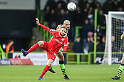 Forest Green Rovers Farrend Rawson(6) beats Scunthorpe United's Kevin van Veen(10) to the ball during the EFL Sky Bet League 2 match between Forest Green Rovers and Scunthorpe United at the New Lawn, Forest Green, United Kingdom on 7 December 2019.