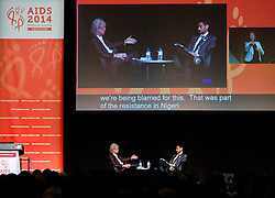 © Licensed to London News Pictures. 24/07/2014. Musician and Campaigner Sir Bob Geldof (left) is interviewed by Waleed Aly (right) during a session of the 20th International AIDS conference held in Melbourne Australia. Photo credit : Asanka Brendon Ratnayake/LNP