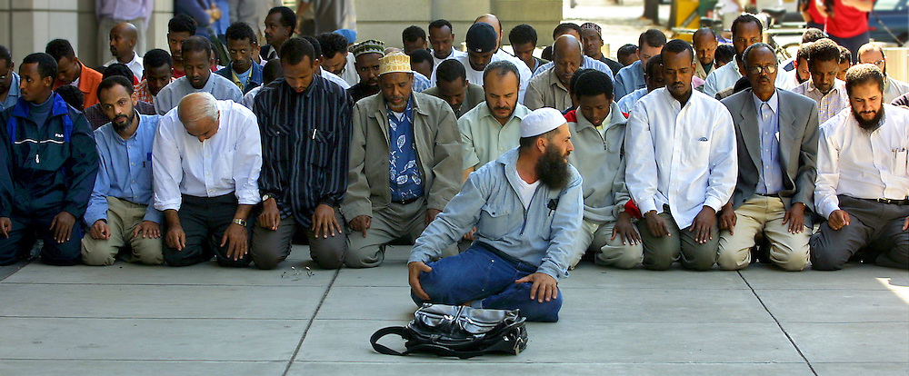 Members of the Islamic Center of Portland-Masjed As-Saber, including Abdulkarim Talal pray outside of the U.S. District Court during the araignment of the mosque's leader Mohamad Abdirahman Kariye.