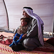 Lafi, 63, (no last name given) tries to calm his grandson Yousef, 2, as he and his family joined other Internally Displaced People fleeing ISIS from Mosul as Iraqi Security Forces move to clear the city of the terror network, at Khazir Camp in Kurdistan Region.