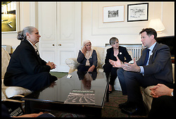 Image ©Licensed to i-Images Picture Agency. 09/07/2014. London, United Kingdom. Hatidza Mehmedovic (left) and Mejra Duguz, mother's of Srebrenica tell The Deputy Prime Minister Nick Clegg their story of the loosing their family members  during Srebrenica massacre 19 years ago.  Picture by Andrew Parsons / i-Images