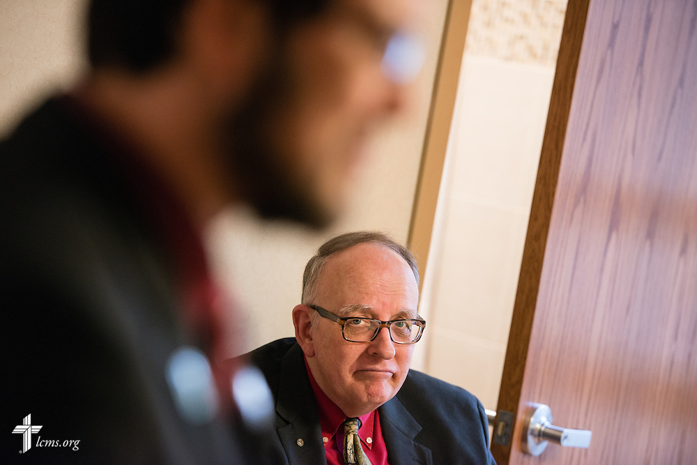 Seminarian Jacob Berlinski (front) of Concordia Seminary, St. Louis, talks with a patient while the Rev. Doug Nicely (rear), chaplain at Memorial Hospital in Belleville, Ill., observes his interaction on Wednesday, Jan. 14, 2015. LCMS Communications/Erik M. Lunsford
