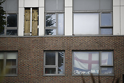 © Licensed to London News Pictures. 25/06/2017. London, UK. Insulation is exposed as a sheet of cladding removed from one of the Chalcots Estate tower blocks in Camden, London on Sunday, 25 June 2017. The Camden Council ordered the evacuation of the towers but there are many residents refusing to leave even though the cladding of the buildings failed the fire safety test. Photo credit: Tolga Akmen/LNP