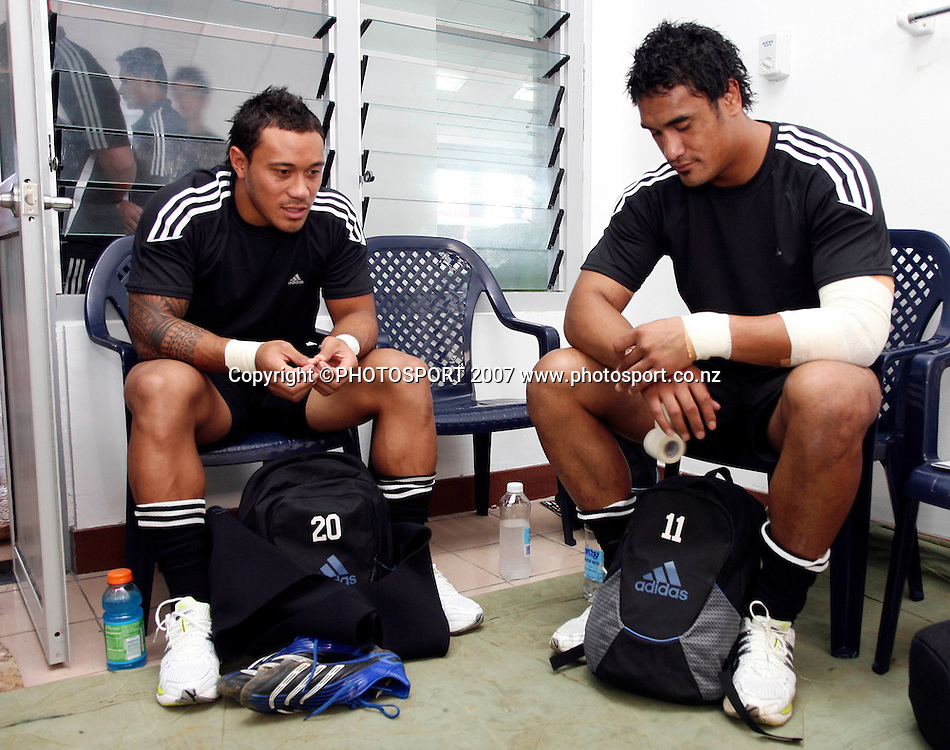 Junior All Blacks' Anthony Tuitavake (L) and Jerome Kaino (R) relax in the dressing room prior to the Pacific Nations Cup rugby union match between Manu Samoa and Junior All Blacks at Apia Park, Apia, Samoa on Saturday 26 May 2007. The Junior All Blacks won the match 31 - 10. Photo: Hagen Hopkins/PHOTOSPORT<br />