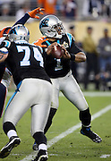 Carolina Panthers tackle Mike Remmers (74) tries unsuccessfully to block Denver Broncos outside linebacker Von Miller (58) who reaches out with both hands and forces a fumble by Carolina Panthers quarterback Cam Newton (1) as Newton drops back to pass late in the fourth quarter. The fumble was recovered by the Denver Broncos setting up the game winning score during the NFL Super Bowl 50 football game against the Carolina Panthers on Sunday, Feb. 7, 2016 in Santa Clara, Calif. The Broncos won the game 24-10. (©Paul Anthony Spinelli)