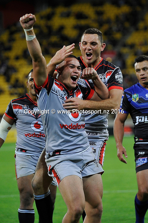 Warriors' Tuimoala Lolohea (L)  celebrates his try with team mate Jonathan Wright during the NRL Warriors vs Bulldogs Rugby League match at the Westpac Stadium in Wellington on Saturday the 16th of April 2016. Copyright Photo by Marty Melville / www.Photosport.nz