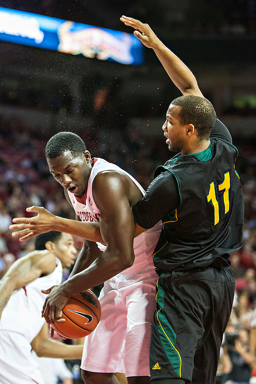 FAYETTEVILLE, AR - DECEMBER 3: Alandise Harris #2 of the Arkansas Razorbacks gets tied up with Antonnio Benton #11 of the SE Louisiana Lions at Bud Walton Arena on December 3, 2013 in Fayetteville, Arkansas.  The Razorbacks defeated the Lions 111-65.  (Photo by Wesley Hitt/Getty Images) *** Local Caption *** Alandise Harris; Antonnio Benton