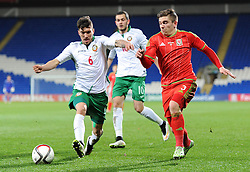 Declan John of Wales u21s (Cardiff City) attempts to pass Hristo Popadyin of Bulgaria u21s - Photo mandatory by-line: Dougie Allward/JMP - Mobile: 07966 386802 - 31/03/2015 - SPORT - Football - Cardiff - Cardiff City Stadium - Wales v Bulgaria - U21s International Friendly