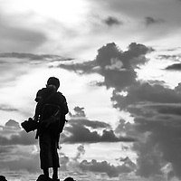Where - Mdura Island, Indonesia.<br /> A boy sells his goods at sunset.