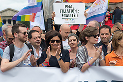 Paris' Mayor Anne Hidalgo (C) claps  during march Gay Pride 2015 in Paris, on June 24th 2017. 2017 marks the 40th anniversary of the first Gay Pride March in the French capital. (Photo by Julien Mattia/NurPhoto) *** Please Use Credit from Credit Field ***