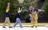 Hutchinson firefighter Adam Frederking directs McCandless fourth-graders Dominic Ford Minor, left, and Lane Williams through the parking lot of Macedonia Missionary Baptist Church to an open lot south of the school Friday afternoon, February 14, 2003. Approximately 475 students and 50 staff members were evacuated from the school after a threat was called in to the school. (AP Photo/The Hutchinson News, Travis Morisse)
