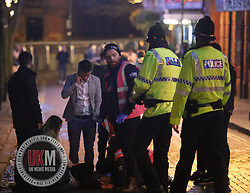 Manchester UK  24.12.2016: Images from Manchesters Gay Village during the Mad Friday celebrations this on the 23 and 24th of December,<br /> <br /> Local Volunteers and police help a man who appears  in need of medical assistance.