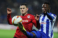 Cardiff city's Craig Conway (l) battles for the ball with Wed's Jermaine Johnson. . NPower championship, Cardiff city v Sheffield Wednesday at the Cardiff city Stadium in Cardiff on Sunday 2nd Dec 2012. pic by Andrew Orchard, Andrew Orchard sports photography,