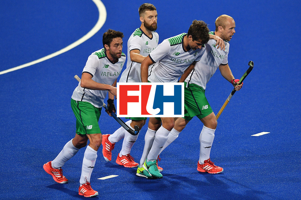 Ireland's John Jermyn (2nd R) celebrates scoring a goal with his teammates during the mens's field hockey Ireland vs Argentina match of the Rio 2016 Olympics Games at the Olympic Hockey Centre in Rio de Janeiro on August, 12 2016. / AFP / Carl DE SOUZA        (Photo credit should read CARL DE SOUZA/AFP/Getty Images)