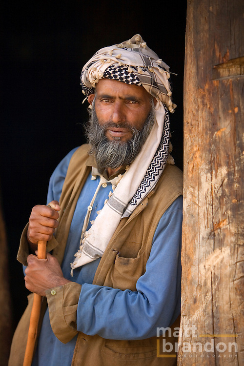 A Gujjar man stands in the doorway of his hut in Lashmir's Lidderwat Valley.