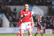 Bristol City forward Peter Odemwingie celebrates scoring his goal, leveling the scores to make it 1-1 during the Sky Bet Championship match between Bristol City and Rotherham United at Ashton Gate, Bristol, England on 5 April 2016. Photo by Graham Hunt.