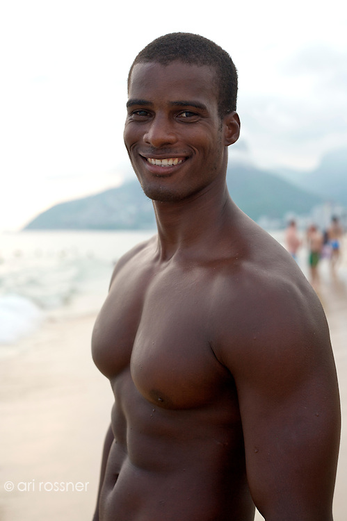 Portrait of gay black Brazilian man on Ipanema beach.<br />