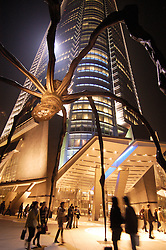 Large spider sculpture  at night outside Mori Building in Roppongi Hills central Tokyo
