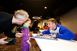 Auguy Slowik of Bristol Rugby signs a flag for a young supporter as Season ticket holders and members of Bristol Sport 7s and Forever Bristol take part in a Bristol Sport Christmas Party - Mandatory byline: Rogan Thomson/JMP - 22/12/2015 - SPORT - Ashton Gate Stadium - Bristol, England - Bristol Sport Christmas at Ashton Gate.
