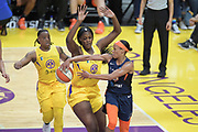Connecticut Sun guard Jasmine Thomas (5) passes the ball behind the back of Los Angeles Sparks center Kalani Brown (21) during a WNBA basketball game, Friday, May 31, 2019, in Los Angeles.The Sparks defeated the Sun 77-70.  (Dylan Stewart/Image of Sport)