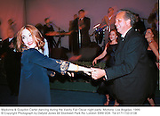 Madonna & Graydon Carter dancing during the Vanity Fair Oscar night party. Mortons. Los Angeles. 1999.<br />
