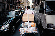 France, Paris, 05-2003..A clandestine Chinese immigrant carries garment between sweat-shop in Paris. He is a new wave of immigrants from China?s northeast, home to millions of former cradle-to-grave factory workers laid off by closures. ..