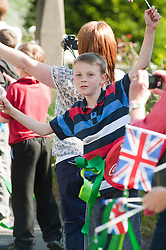 The Olympic Torch relay reaches Sheffield on day 38 coverage from the Chapeltown - Ecclesfield - Parson Cross section of the Journey. Crowds<br />