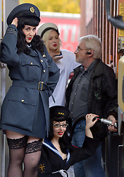 © Licensed to London News Pictures. 12/11/2012. London, UK Lorry and HGV drivers arriving at Clacket Lane Services got more than they bargained for when filling up their petrol tanks this morning.  Drivers were greeted by a group of 1940s Forces' Sweethearts who were manning the pumps to help launch a campaign to tell younger Veterans about the support available to them from military charity, SSAFA Forces Help. Recent figures indicate that nearly 15% of Britain's lorry drivers have once served in the Armed Forces and SSAFA has set out to target these truckers to make them aware of the lifelong support it provides to them and their former comrades.. Photo credit : Stephen Simpson/LNP