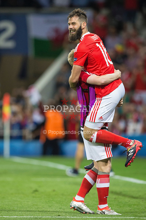 TOULOUSE, FRANCE - Monday, June 20, 2016: Wales' Joe Ledley and Jonathan Williams celebrate the 3-0 victory and progression into the knockout stages after the final Group B UEFA Euro 2016 Championship match at Stadium de Toulouse. (Pic by Paul Greenwood/Propaganda)