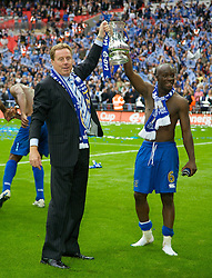 LONDON, ENGLAND - Saturday, May 17, 2008: Portsmouth's manager Harry Redknapp and Lassana Diarra celebrate with the trophy after beating Cardiff City 1-0 during the FA Cup Final at Wembley Stadium. (Photo by David Rawcliffe/Propaganda)