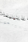 ski lift bringing skiers up the mountain