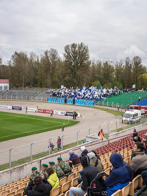 Fans of FC Dinamo Minsk watch a game at the team's Traktor Stadium on Sunday, September 25, 2016 in Minsk, Belarus.