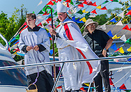 Seminarian Joey Dunbar, Catholic Archbishop Thomas J. Rodi, and Rev. Bieu Nguyen, pastor of St. Margaret's Catholic Church, stand on the deck of a boat during the 65th annual Blessing of the Fleet in Bayou La Batre, Alabama, May 4, 2014. The first fleet blessing was held by St. Margaret's Catholic Church in 1949, carrying on a long European tradition of asking God's favor for a bountiful seafood harvest and protection from the perils of the sea. The highlight of the event is a blessing of the boats by the local Catholic archbishop and the tossing of a ceremonial wreath in memory of those who have lost their lives at sea. The event also includes a land parade and a parade of decorated boats that slowly cruise through the bayou. (Photo by Carmen K. Sisson/Cloudybright)