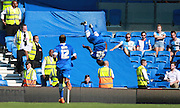 Brighton midfielder winger Kazenga LuaLua celebrates in his trademark style after opening the scoring during the Sky Bet Championship match between Brighton and Hove Albion and Blackburn Rovers at the American Express Community Stadium, Brighton and Hove, England on 22 August 2015. Photo by Bennett Dean.