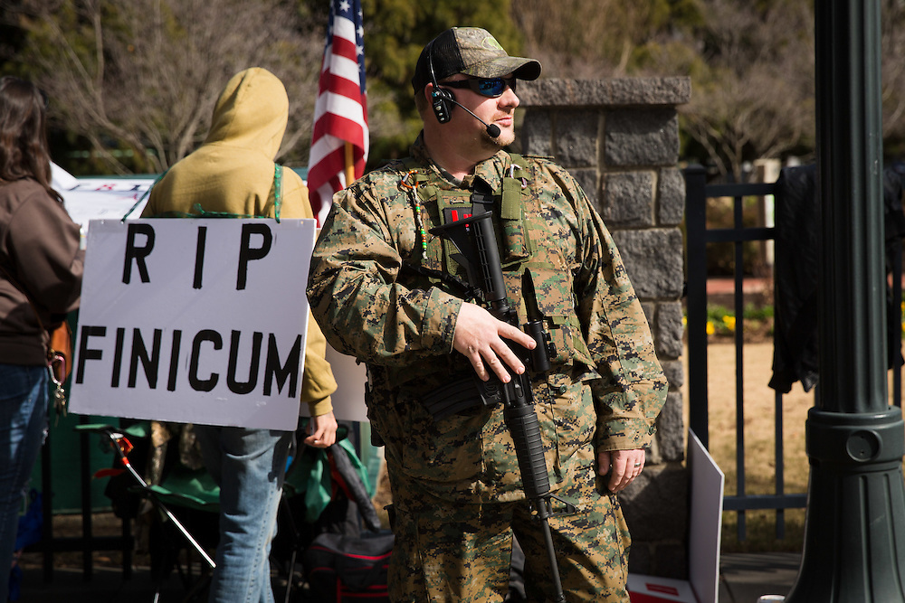 "The Georgia Security Force III% militia holds a protest on Marietta Street in downtown Atlanta on Saturday, Feb. 6, 2016. The protest was partly inspired by the death of LaVoy Finicum by federal authorities. Pictured here is William ""Snake"" Ray, member of GSF III%. Photo by Kevin D. Liles/kevindliles.com"