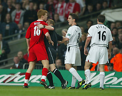 CARDIFF, WALES - Sunday, March 2, 2003: Referee Paul Durkin steps in to seperate Liverpool's John Arne Riise and Manchester United's Roy Keane during the Football League Cup Final at the Millennium Stadium. (Pic by David Rawcliffe/Propaganda)