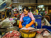 10 JULY 2018 - NAKHON PATHOM, THAILAND:  A fish seller in the market in Nakhon Pathom. Nakhon Pathom is about 35 miles west of Bangkok. It is one of the oldest cities in Thailand, archeological evidence suggests there was a settlement on the site of present Nakhon Pathom in the 6th century CE, centuries before the Siamese empires existed. The city is widely considered the first Buddhist community in Thailand and the nearly 400 foot tall Phra Pathom Chedi is considered the first Buddhist temple in Thailand.    PHOTO BY JACK KURTZ
