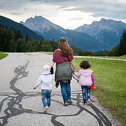 "Afternoon, Wednesday 16th of September 2015. Zinkenwirt Gmerk, Berchtesgaden, Bavaria. Aysha and her daughters are now in Germany. The landscape remind me of the movie ""The Sound of Music""  They walked few meters to a bus station where they were planning to take the bus to the nearest train station and fro there to continue to Munich. Few minutes after this picture was taken a van of the Bavarian State Police came and pic them up. They were taken to a refugee first welcome centre where I would meet them few hours later. Then we took the train to Munich where the were taken to the refugee centre. I wouldn't meet them for 5 months."