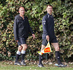 © Licensed to London News Pictures . 28/09/2014 . Birmingham , UK . Health Secretary JEREMY HUNT (right) serves as linesman during the match , with a mentor . Hunt , who is newly qualified as a linesman , received support from a mentor during the match . Conservative Party vs Journalists football match at a Birmingham University football pitch , at the start of the conference . The 2014 Conservative Party Conference in Birmingham . Photo credit : Joel Goodman/LNP
