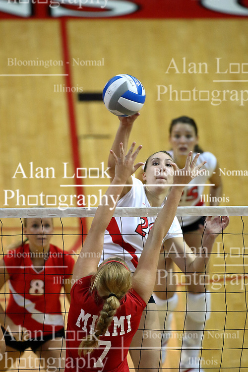 25 AUG 2007: Kari Staehlin reaches for a hit, Emily Schroeder goes for the block. By a score of 3 games to 1,  Illinois State University Redbirds defeated the Redhawks of Miami of Ohio at Redbird Arena on the campus of Illinois State University in Normal Illinois.