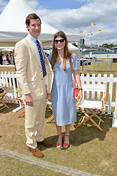 FIN BULLOUGH and CARINTHIA PEARSON at the Jaeger-LeCoultre Gold Cup Polo Final held at Cowdray Park Polo Club, Midhurst, West Sussex on 19th July 2015
