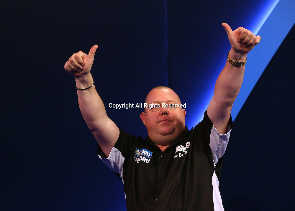 23.12.2016. Alexandra Palace, London, England. William Hill PDC World Darts Championship. Melvyn King gives fans the thumbs up, as he walk to the Oche, for his match with Michael Smith