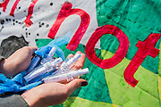 Protestors try to send BP a message in a bottle. Environmental protestors outside the BP AGM at the Excel Centre. They are highlighting the dangers of deep sea drilling and the damage to the Gulf. As well as being anti tar sands oil and the general impact of burning fossil fuels on the environment.