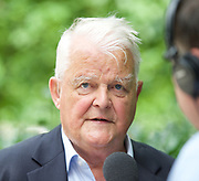 CND and Stop The War Rally outside the US Embassy, London, Great Britain <br /> 11th August 2017 <br /> <br /> Bruce Kent being interviewed outside the US Embassy in London <br /> <br /> Delegation calls for end to nuclear brinkmanship<br /> <br /> A delegation of journalists, writers, playwrights and anti-war activists will visit the US Embassy today to deliver a letter to the US ambassador to Britain. The letter calls on Donald Trump to desist from inflammatory statements and behaviour which is taking us to the brink of nuclear war.  <br /> <br /> Members of the delegation believe that Donald Trump's recent comments - threatening North Korea with &quot;fire and fury like the world has never seen&quot; - have significantly increased the risk of outright military conflict. War with North Korea is now a real possibility unless a very different approach is adopted by Britain's main ally.<br /> <br /> <br /> Photograph by Elliott Franks <br /> Image licensed to Elliott Franks Photography Services