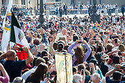 Pope Francis waves to faithful as he arrives for his weekly general audience in St Peter's square at the Vatican on April 25, 2018.